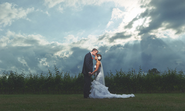 epic clouds wedding portrait